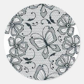 Modelo de la danza de la mariposa y de la flor del pegatina redonda