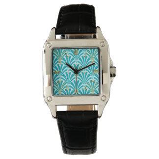 Modelo de la fan del art déco - turquesa en la reloj de mano