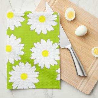 Modelo de la margarita en el sistema del verde de toalla de cocina
