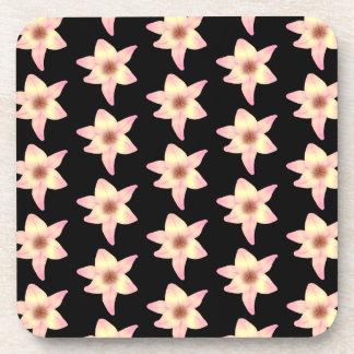 Modelo de las flores del lirio en negro posavaso