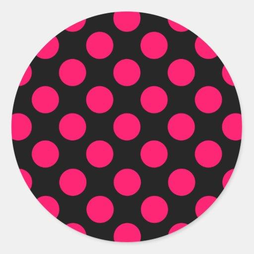 Modelo de lunares de las rosas fuertes y del negro etiqueta redonda