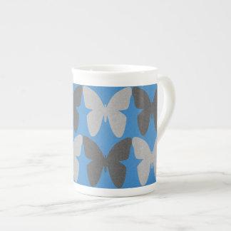 Modelo de mariposa azul y gris taza de té