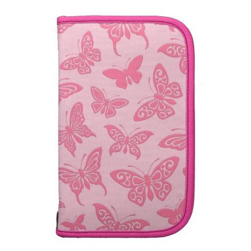 Modelo de mariposas rosado que vuela planificador