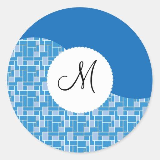 Modelo de onda azul de la teja de la inicial de en etiquetas redondas