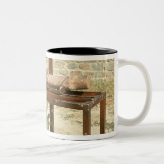Modelo de una sierra hidráulica tazas de café