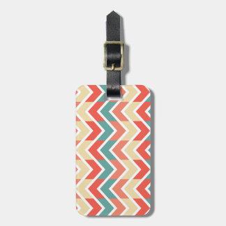 Modelo de zigzag azul rosado del extracto del etiqueta de equipaje