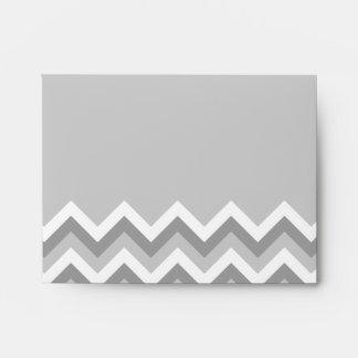 Modelo de zigzag gris y blanco. Gris llano de la p Sobres