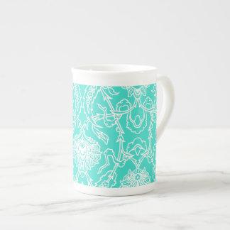 Modelo decorativo de la turquesa de lujo y del taza de porcelana