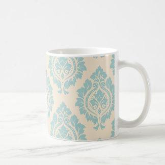 Modelo decorativo del damasco - azul en la crema taza clásica