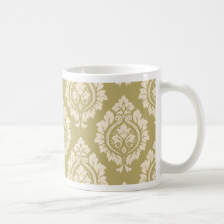 Modelo decorativo del damasco - crema en el oro taza