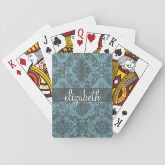 Modelo del damasco del vintage con el monograma baraja de cartas