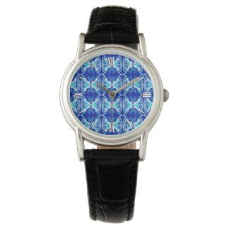 Modelo del papel pintado del art déco - azul y relojes de mano