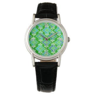 Modelo del papel pintado del art déco, verde de relojes de pulsera