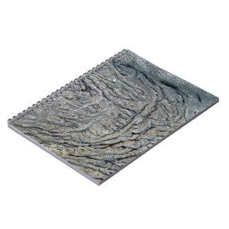Modelo del remolino en superficie rocosa oscura libros de apuntes