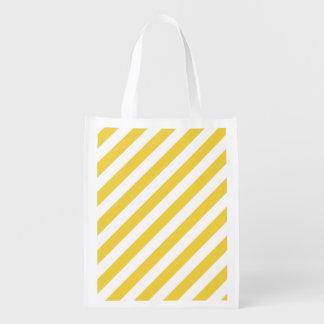 Modelo diagonal amarillo y blanco de las rayas bolsas de la compra