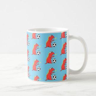 Modelo divertido azul del fútbol del dinosaurio taza de café