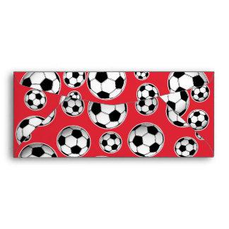 Modelo divertido rojo del balón de fútbol sobre