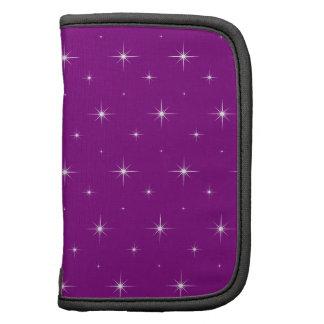 Modelo elegante de las estrellas púrpuras y brilla organizadores