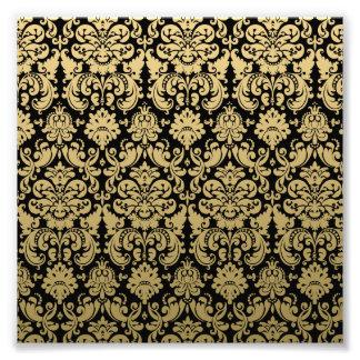 Modelo elegante del oro y del damasco del negro fotografía