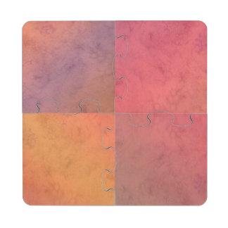 Modelo en colores pastel rosado de la acuarela del posavasos de puzzle