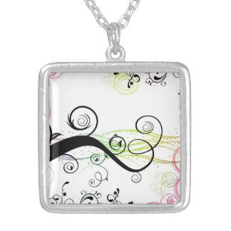 Modelo espiral con las hojas y los círculos joyerías