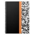 Modelo floral anaranjado y negro del damasco libros de apuntes