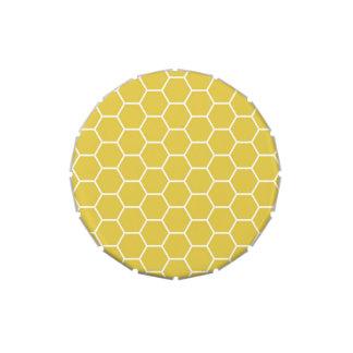 Modelo geométrico amarillo de moda del hexágono de latas de caramelos