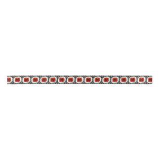 Modelo geométrico de la flor roja decorativa de lazo de raso