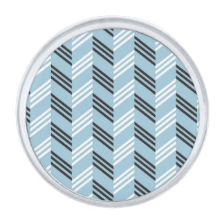 Modelo geométrico del zigzag azul de moda de la insignia plateada