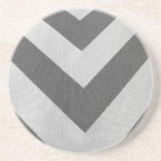 Modelo gris blanco del galón de la textura del posavasos para bebidas