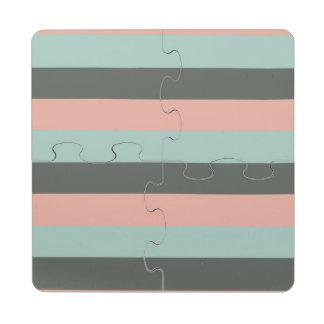 Modelo gris rosado de las rayas del trullo posavasos de puzzle