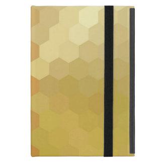 Modelo inconsútil del hexágono amarillo y iPad mini funda