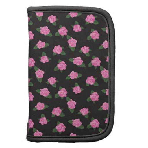 Modelo lindo de las flores color de rosa florales  planificadores
