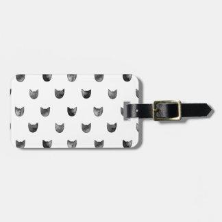 Modelo lindo elegante blanco y negro del gato etiqueta para maleta