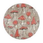 Modelo manchado de los hongos rojos y blancos tabla para cortar