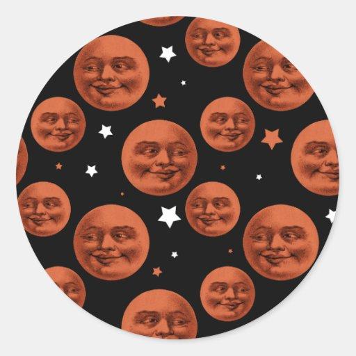 Modelo negro anaranjado de la luna del vintage pegatina redonda