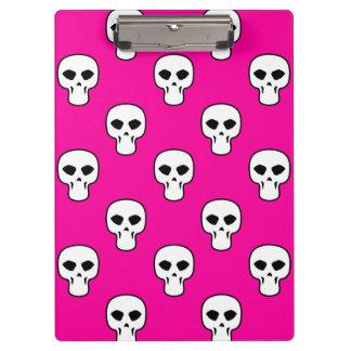 Modelo negro, blanco, rosado de los cráneos