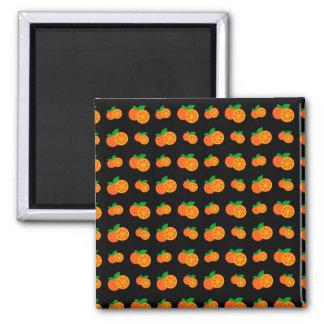 Modelo negro de los naranjas imán cuadrado