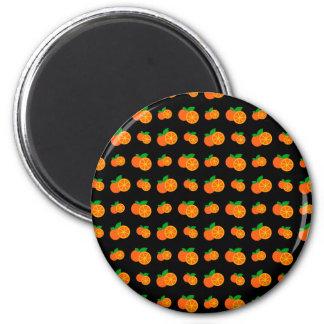 Modelo negro de los naranjas imán redondo 5 cm