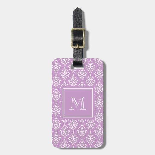 Modelo púrpura 1 del damasco con el monograma etiqueta para equipaje
