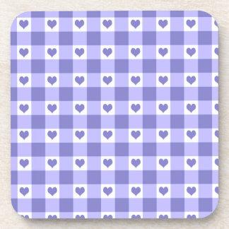 Modelo púrpura y blanco de los corazones del apoyavasos