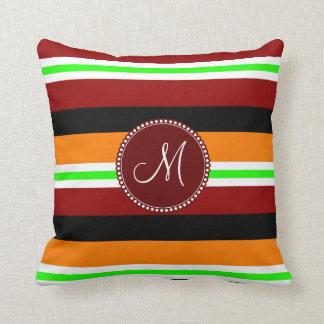 Modelo rayado negro verde anaranjado rojo del mono almohadas