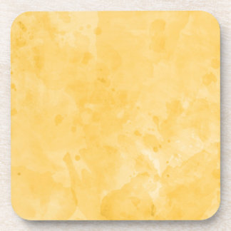 Modelo retro amarillo de la textura de la salpicad posavasos de bebida
