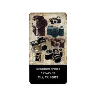 Modelo retro de las cámaras del Grunge del vintage Etiqueta De Dirección