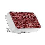 Modelo retro enrrollado rojo, blanco y negro de la notebook altavoz