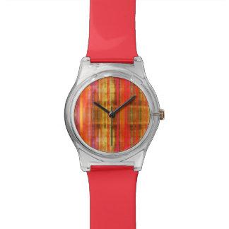 Modelo rojo amarillo rosado femenino de las rayas relojes de mano