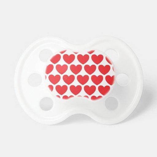 Modelo rojo de los corazones chupetes de bebe