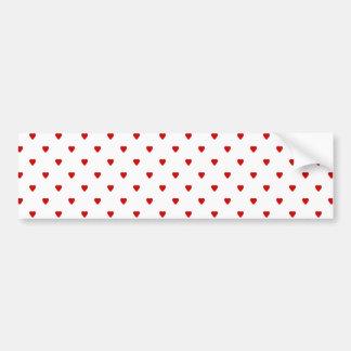 Modelo rojo de los corazones en un fondo blanco pegatina para auto