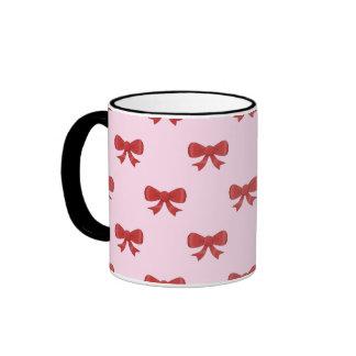 Modelo rojo del arco de la cinta en rosa taza de dos colores