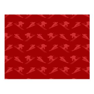 Modelo rojo del esquí tarjetas postales